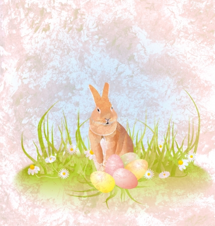 brown hare or rabbit sitting in the grass with easter eggs and daisies grunge photo