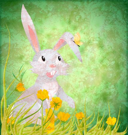 Easter rabbit with yellowflowers on grunge paper green background photo