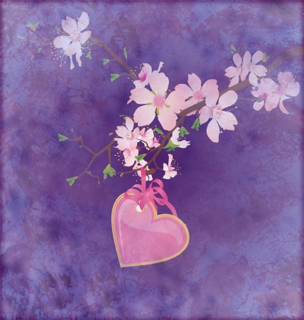 pink heart hanging on the blooming tree brunch on grunge dark blue background photo