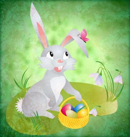 easter bunny with busket and eggs on green grunge backdrop with grass and flowers photo