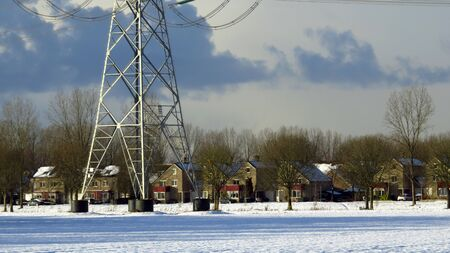 Modern Residential Houses and Transmission Tower Covered in Snow Stock fotó