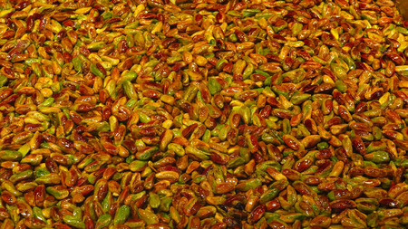 Green Peeled Oil Fried Pistachio Nuts as Background