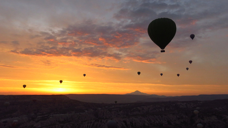 Silhouette of Hot Air Balloons Flying Over Cappadocia at Dawn