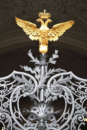 Russia, Petersburg, Winter palace, the arms on a gate photo