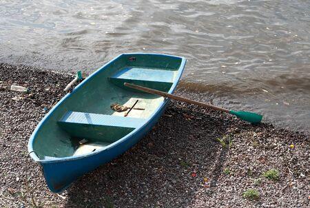 skiff: Boat on the shore Stock Photo