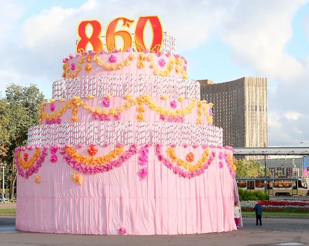 Enormous mock-up of cake, established over the area photo