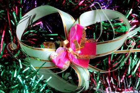New-year adornments, tinsel and many-colored ribbon photo