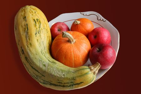 Large dish with the vegetables and the fruits against the dark background photo