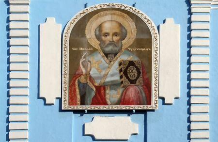 Icons of St. Nicholas Chudotvortsa on the wall of the church photo