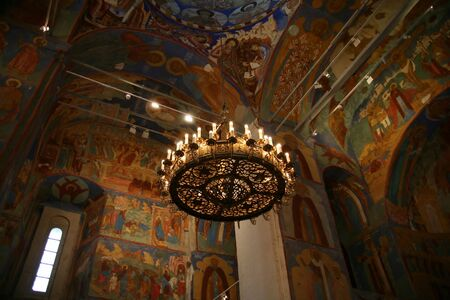 iconography: Large chandelier and icon on the walls in Spaso- Preobrazhenskiy the cathedral Stock Photo