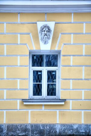 heads old building facade: Window Stock Photo