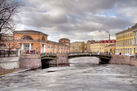 Ancient bridge across the river the Moika  Stock Photo