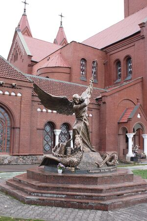 Sculpture Archangel Michael pierces a serpent photo