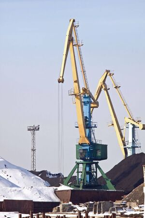 anthracite coal: Gantry-cranes and heaps of anthracite coal in the seaport of Murmansk city