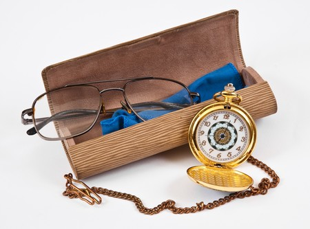 Glasses, eyeglass case and the clock photo
