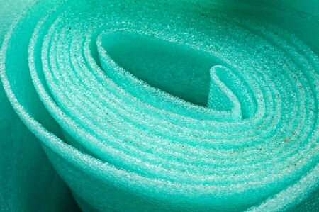 polyethylene: Building material is a polyethylene, green background Stock Photo