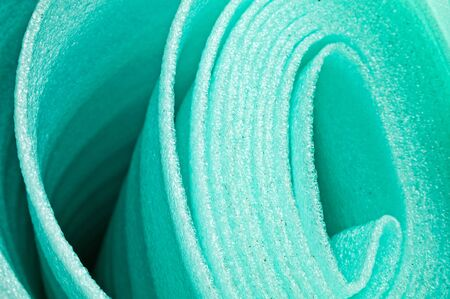 building material: Building material is a polyethylene, green background Stock Photo