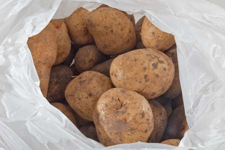 seminal: Potatoes in the cellophane packet Stock Photo