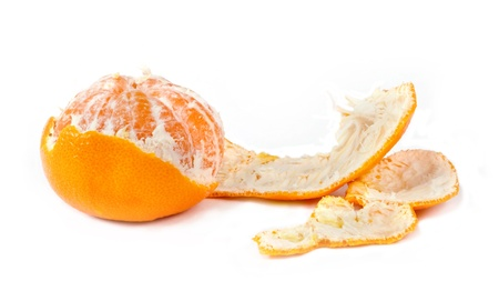 Ripe mandarin against the white background photo