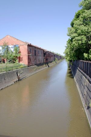 Old channel along the facades of merchant stores