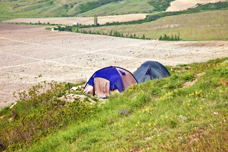 vineyard plain: Tourist tents on verge of plateau