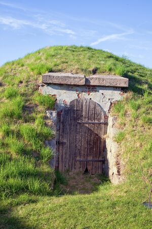 dwelling mound: Bunker with a thick door in earthen hill