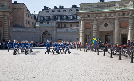 infantryman: Stockholm. May 2013. Changing of the guard ceremony with the participation of the Royal Guard cavalry. The colorful ceremony attracts many tourists and has become a tourist sights