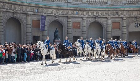 cavalryman: Stockholm. May 2013. Changing of the guard ceremony with the participation of the Royal Guard cavalry. The colorful ceremony attracts many tourists and has become a tourist sights