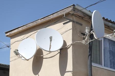 parabolic mirror: Receiving aerials of satellite television Stock Photo