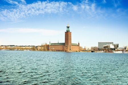 crown spire: Stockholm. Town hall on the lake of Malaren