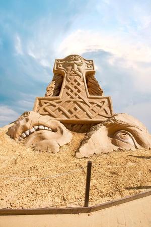 Sculpture from sand. Work of art, doomed to death from a rain and wind photo