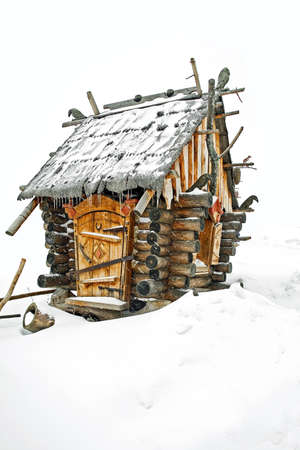 Fairytale log cabin in a strong snowfall photo