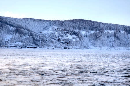 Very nipping frost on the river Angara. Siberia  photo
