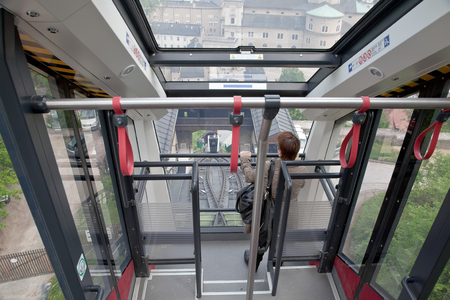 guardrails: Interior of carriage of funicular is in city Salzburg Editorial