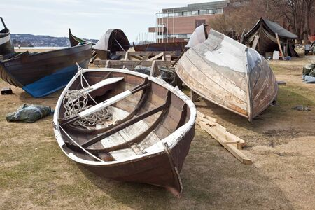 skiff: Large launches lying on the shore for repairs