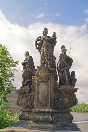 Ancient sculpture on the Charles Bridge. Prague. St. Barbara, Margaret and Elizabeth