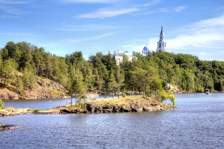 View of the coast of the island of Valaam and the dome of the Orthodox church Stock Photo - 25039205
