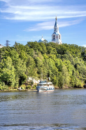 View of the coast of the island of Valaam and the dome of the Orthodox church photo