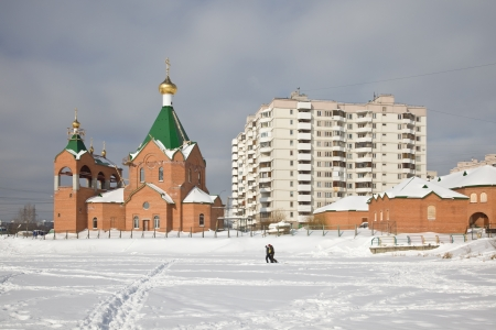 Moscow, municipal landscape. Church ashore the frozen lake photo