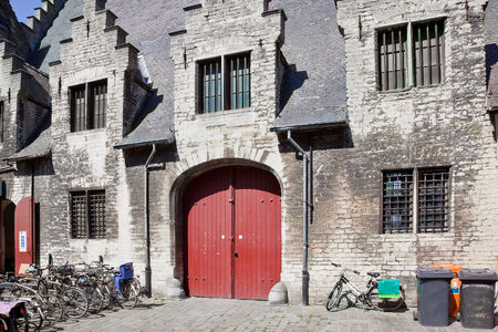 Gates and facade of an old mansion in Ghent photo