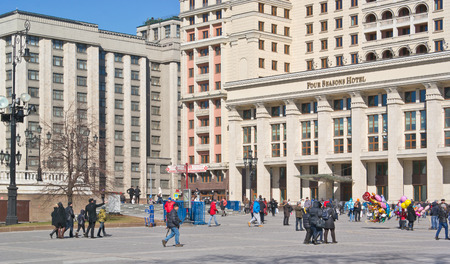 duma: RUSSIA, MOSCOW - March 29,2014: View of the facade of the new Hotel Moskva from Manege Square and the State Duma