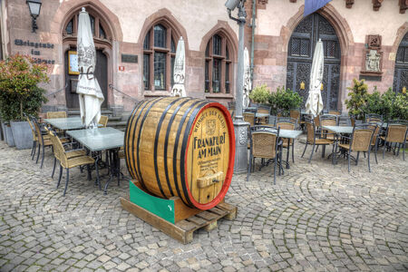 GERMANY, FRANKFURT AM MAIN - May 07.2014: Huge oak barrel, which promotes quality of beer in a restaurant