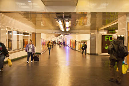 inwardly: FRANCE, PARIS — April 30.2014: Pedestrian tunnel to subway station