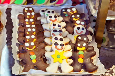 SPAIN, AVILA - May 03.2014: Funny cakes in the form of little people in the window of a confectionery shop