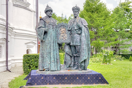 sights of moscow: RUSSIA, MOSCOW — June 18.2014: Monument on the territory Novospasskogo Monastery is a sculptural composition depicting the first king of the Romanov Mikhail Fyodorovich and last - Tsar Nicholas II martyr