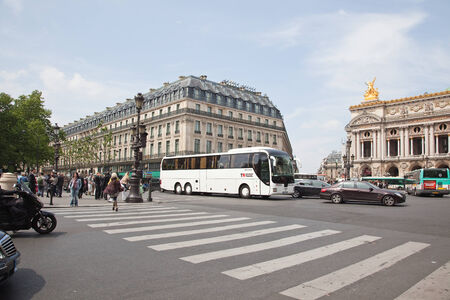 FRANCE, PARIS - May 03.2014: Squares and streets of historical center of ancient city. Grand Opera in the Plaza Opera