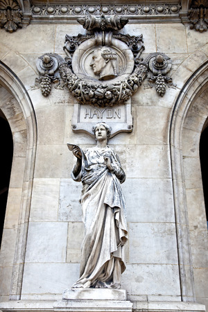 An ancient sculptural group Sculpture is girls and high relief of composer Haydn. Facade of Opera Granier photo