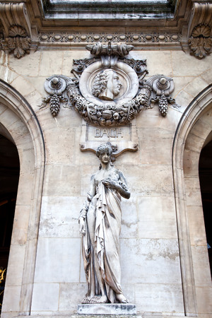 An ancient sculptural group Sculpture is girls and high relief of composer Bach. Facade of Opera Granier