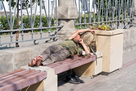 RUSSIA, MOSCOW - August 04. 2014: homeless man Sleeping on a bench