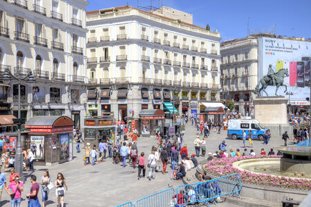 Spain, Madrid - May 02.2014: The historic main square Puerta del Sol of the city and the crowds of tourists